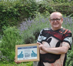 Growing Works Volunteer holds certificate at Almondbury Allotment